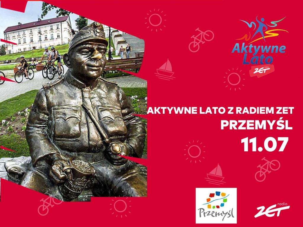Baner promujący Aktywne Lato z radiem ZET - zdjęcie figury Szejka w Przemyskim Rynku - napis Aktywne Lato z radiem ZET Przemyśl 11.07, logo miasta i radia ZET